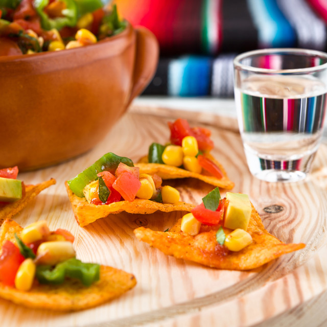 """Close up of nachos chips and tequila"" stock image"
