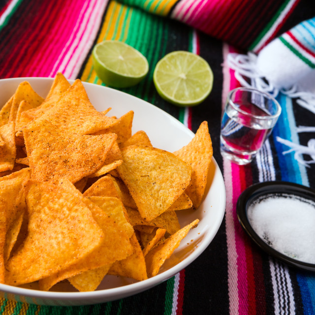 """Nachos chips in a bowl tequila lime and salt"" stock image"