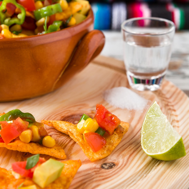 """Nachos chips with vegetables tequila lime and salt"" stock image"