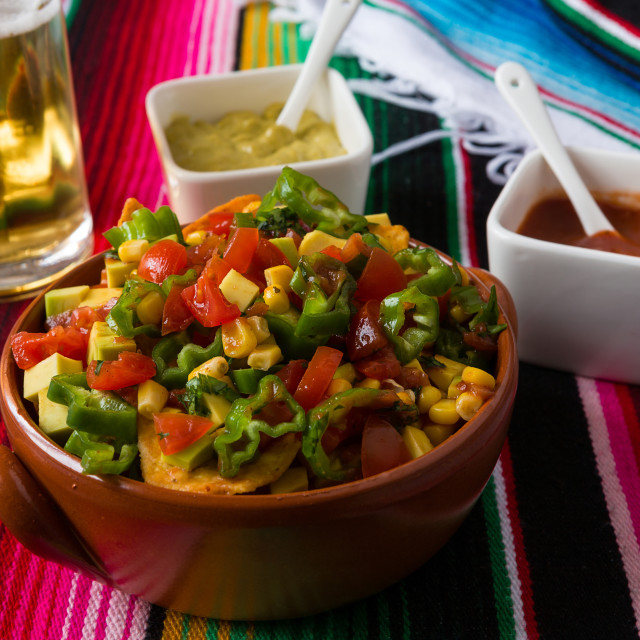 """Nachos salad hot sauces and beer"" stock image"