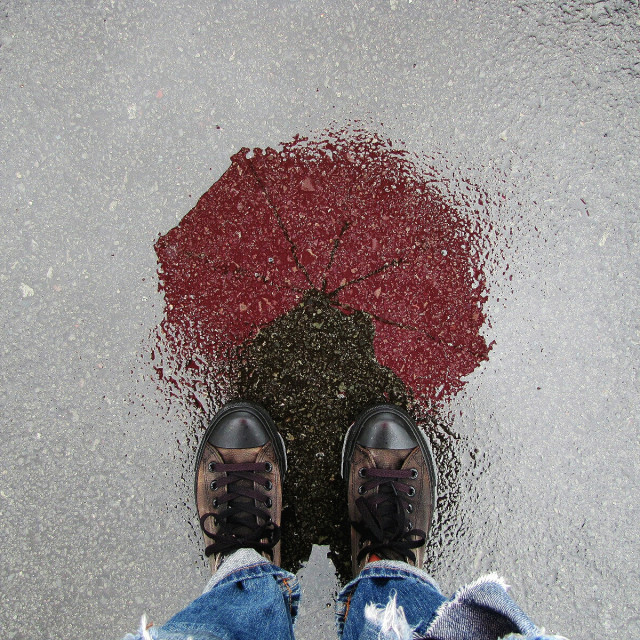 """Rainy walks with red"" stock image"