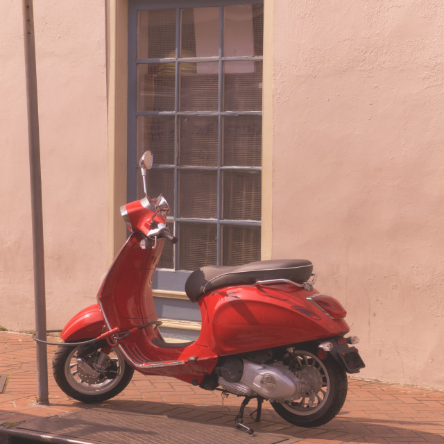 """Red Scooter in a street of New Orleans, USA"" stock image"