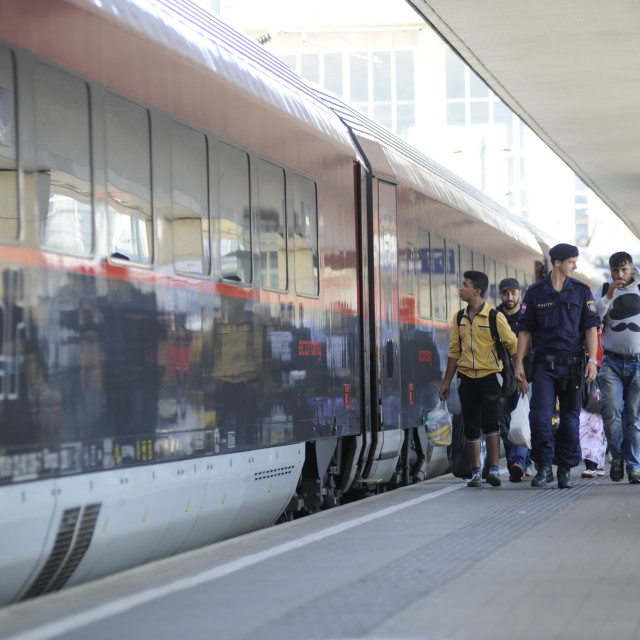 """""""Refugees at the Westbahnhof in Vienna are waiting for the journey to Germany"""" stock image"""