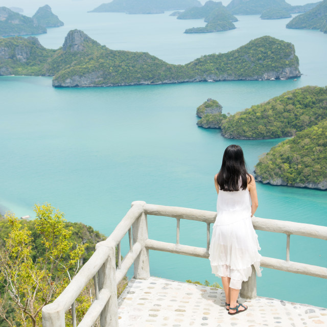 """woman enjoying stunning view at the small islands"" stock image"