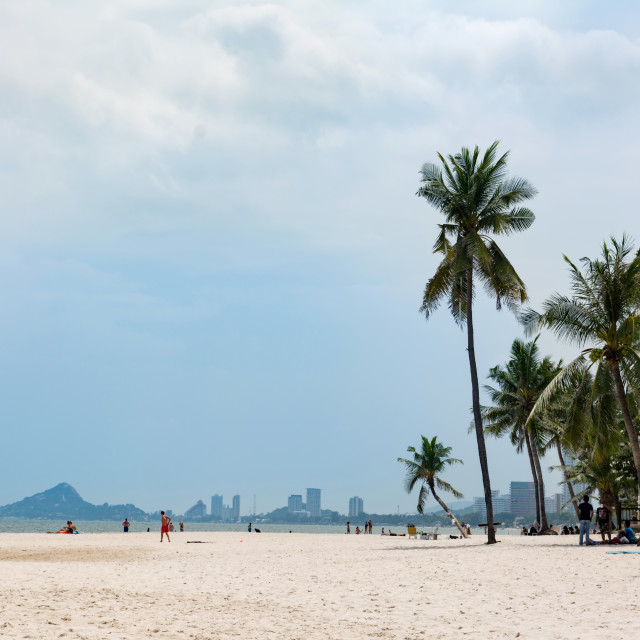 """""""Hua Hin, Thailand - October 23, 2016: View at city beach at daytime with few tourists sunbathing"""" stock image"""