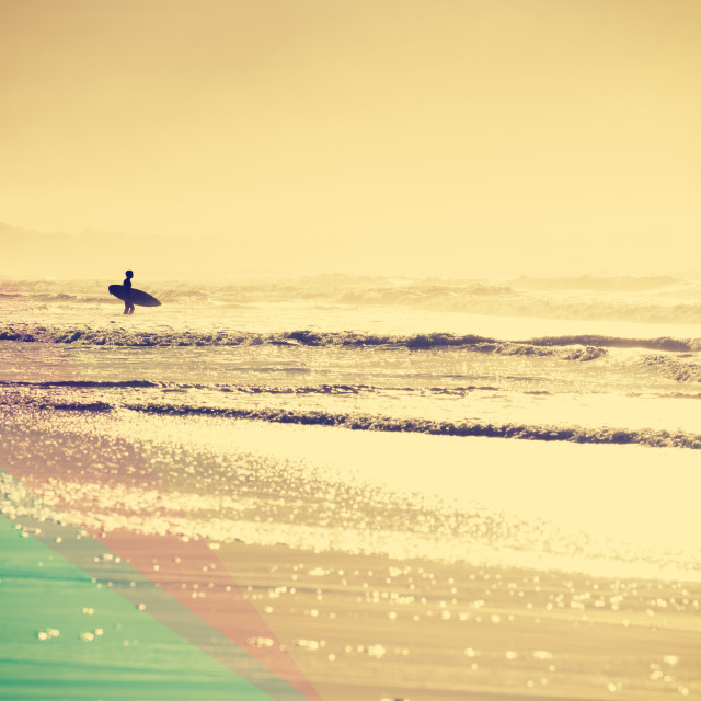 """Vintage summer beach with surfer in the water"" stock image"