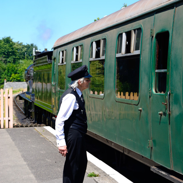 """Station Guard on Corfe Castle Railway"" stock image"