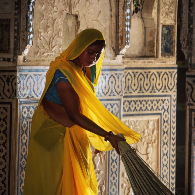"""Woman sweeping at Amber Palace"" stock image"