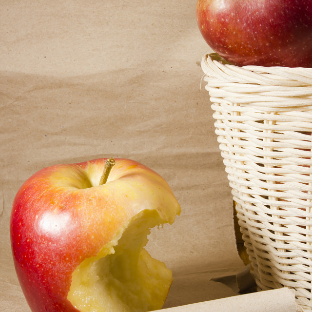 """Apple core and a basket with apples"" stock image"
