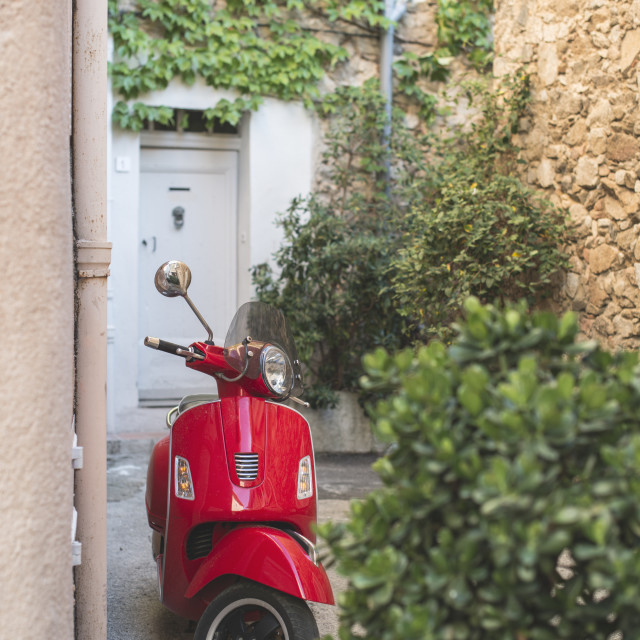 """Red Italian moped"" stock image"