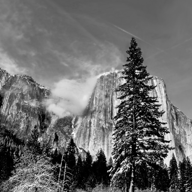"""clouds forming on the granite peaks in Yosemite valley"" stock image"