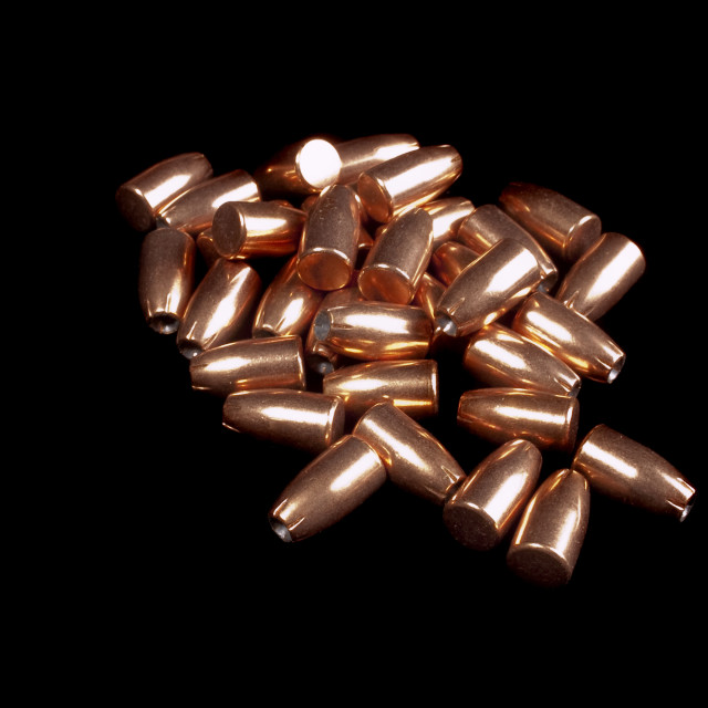 """9mm bullets on black"" stock image"