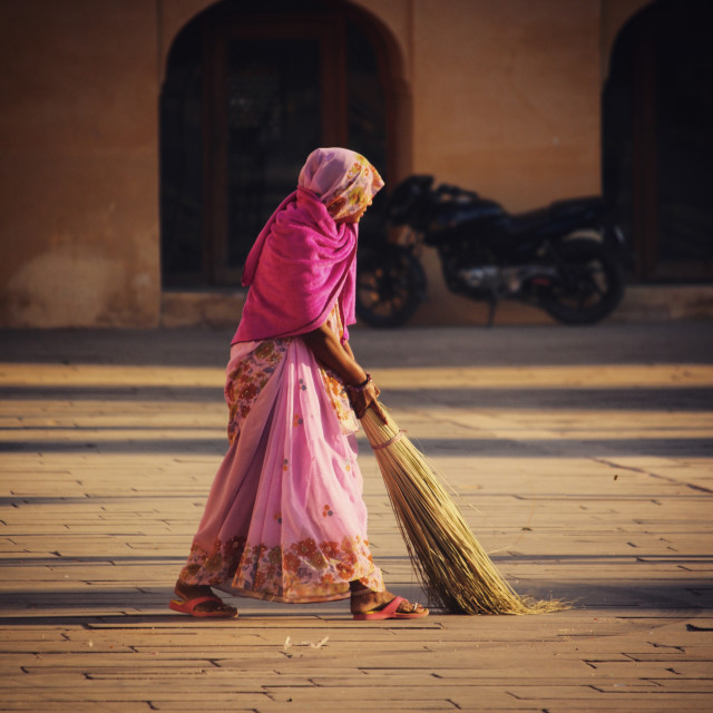 """Indian woman sweeping at Amber Palace"" stock image"