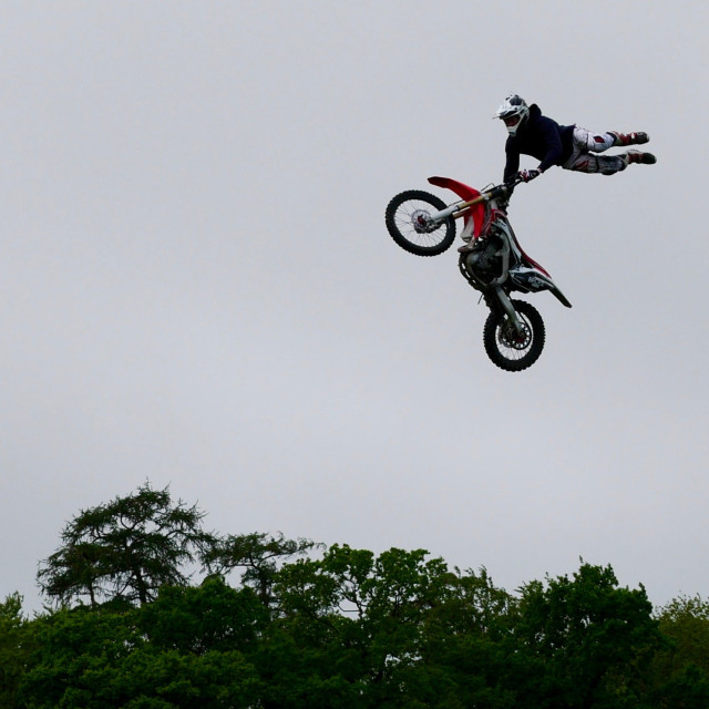 """Stunt motorcyclist flying through the air"" stock image"