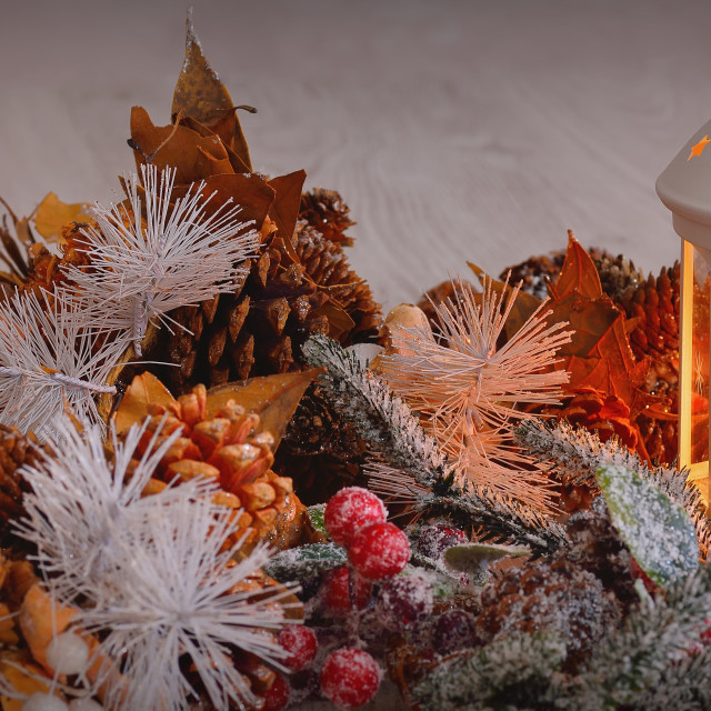 """Close-up of christmas wreath with burning candle inside lantern"" stock image"
