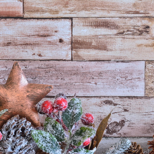 """""""Close up of decorative Christmas star with fir branch with cones powdered with snowflakes on wooden background"""" stock image"""