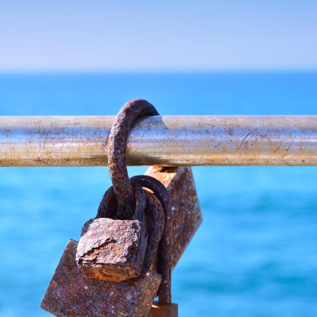 """Rusty love locks on railing"" stock image"