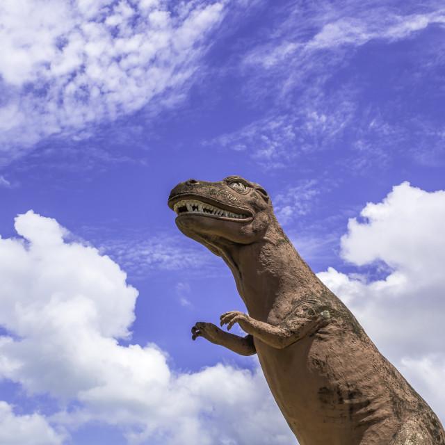 """Dinosaur statue with blue sky"" stock image"