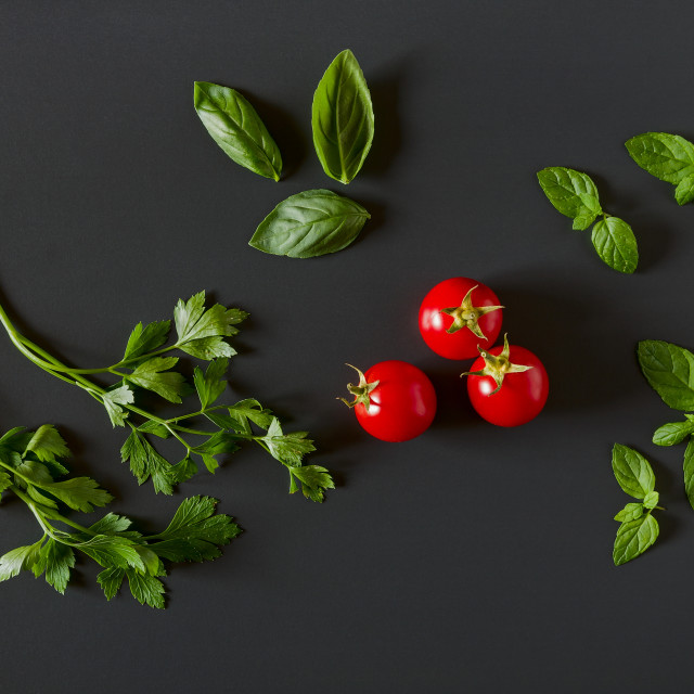 """Green vegetables around three red tomatoes"" stock image"