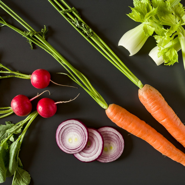"""Fresh raw vegetables over a dark background"" stock image"