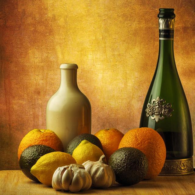 """Still life bottles and fruit"" stock image"