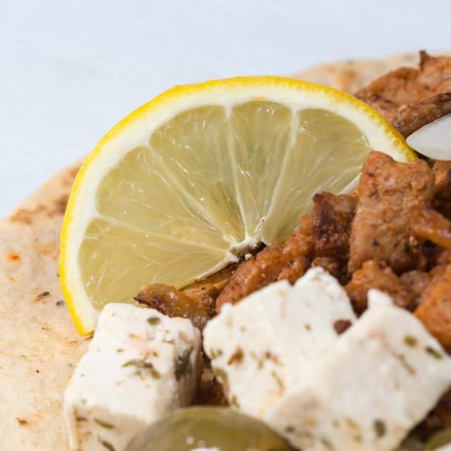 """Gyros pita with tzatziki coleslaw olives and feta cheese"" stock image"