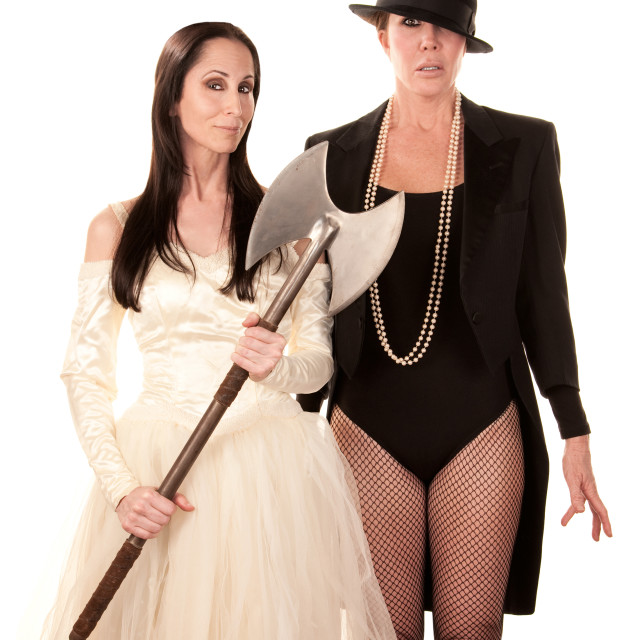 """Two women as bride and groom with axe"" stock image"