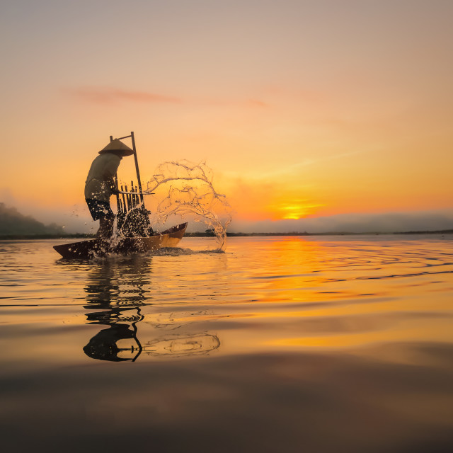 """Fishermen in action when fishing in the river"" stock image"