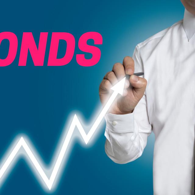 """bonds trader draws market price on touchscreen"" stock image"