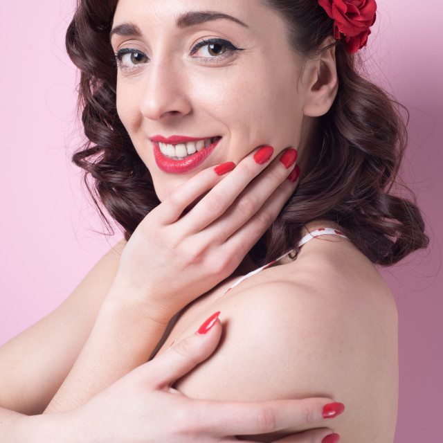 """""""cute girl smiling with rose in hair"""" stock image"""