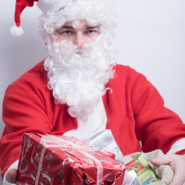 """Santa giving present"" stock image"