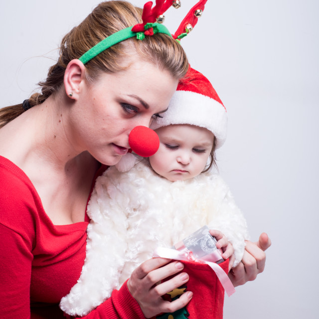 """""""mom and baby looking presents"""" stock image"""