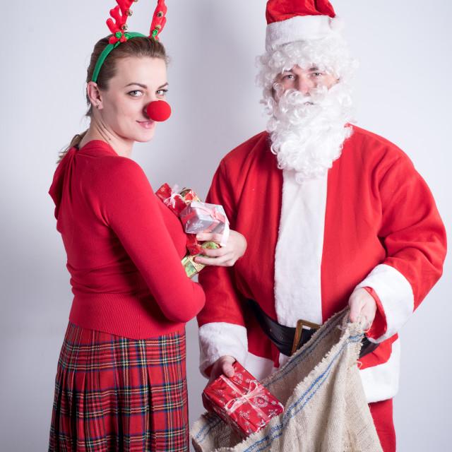 """Santa and his helper"" stock image"