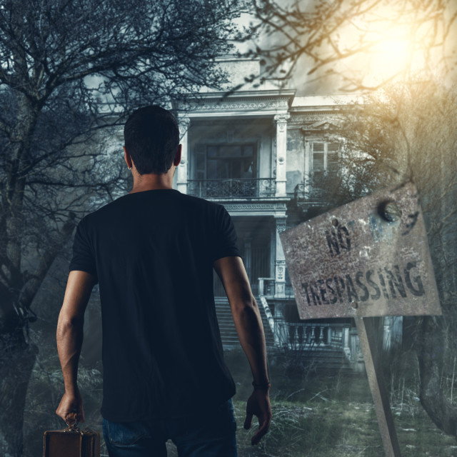 """Man walking toward the haunted house"" stock image"