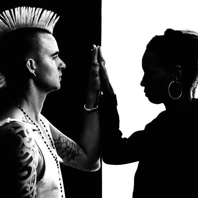 """""""Man with Mohawk and Woman with Dreadlocks"""" stock image"""