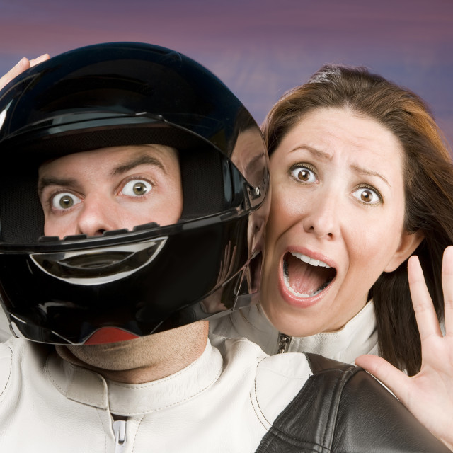"""""""Man and fearful woman on a motorcycle"""" stock image"""