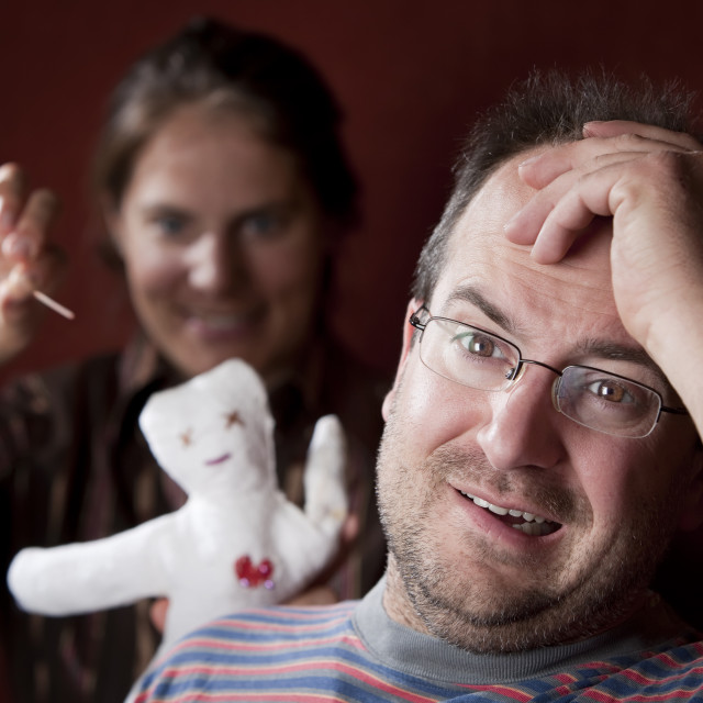 """""""Upset woman with vioodoo doll and guilty man"""" stock image"""