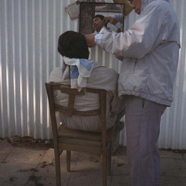 """""""Hanoi Street Barber"""" stock image"""