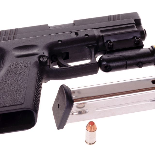 """""""40 caliber semi-automatic handgun with a laser site attached"""" stock image"""