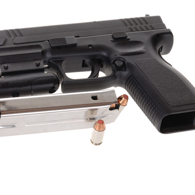 """""""Semi-auto handgun equipped with a laser sight, and a magazine isolated on white"""" stock image"""