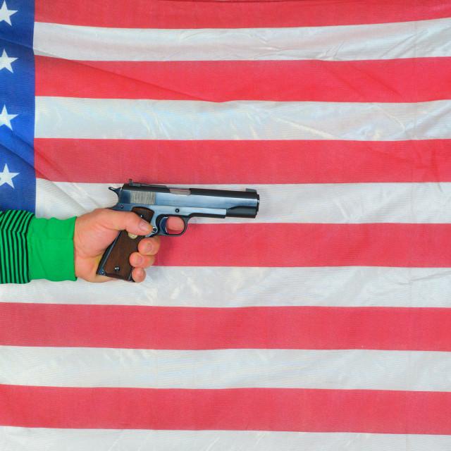 """hand holding a.45 ACP semi-automatic handgun"" stock image"
