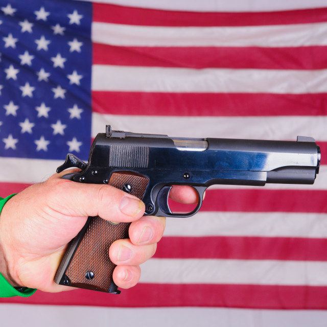 """""""Left-handed shooter holding semi-automatic pistol"""" stock image"""