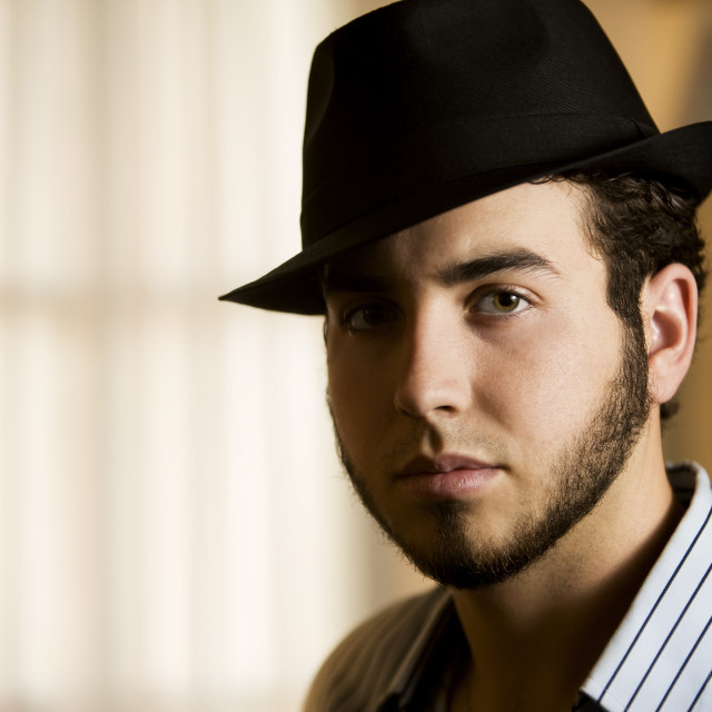 """""""Young Man in a Fedora"""" stock image"""
