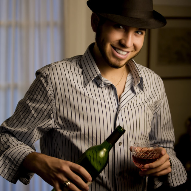 """""""Young Man in a Fedora with Red Wine"""" stock image"""