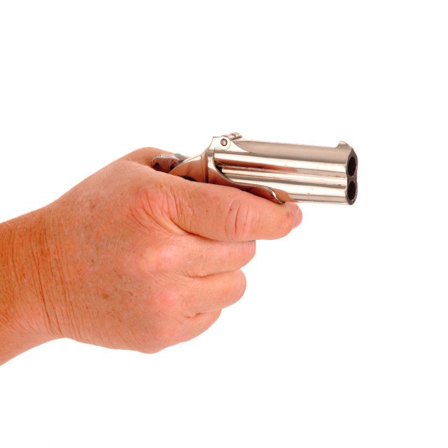 """""""Derringer cocked in a hand isolated on white"""" stock image"""