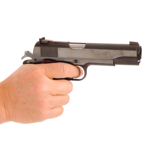"""gun in hand on white"" stock image"