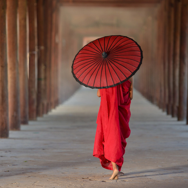 """Monk walking on ancient temple,Bagan Myanmar"" stock image"