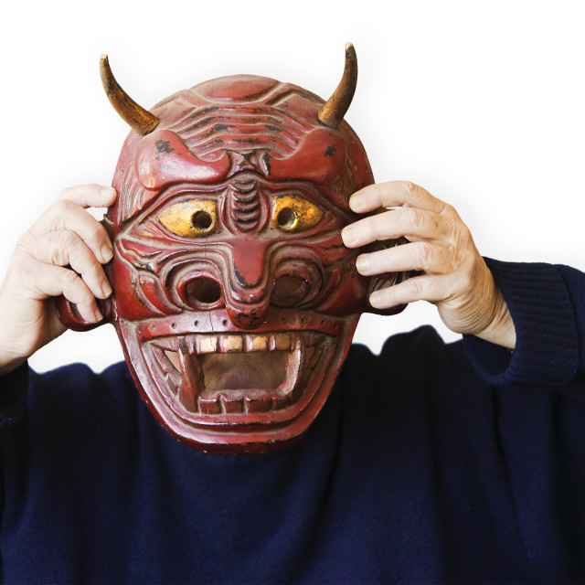 """Person Holding Up A Devil Mask"" stock image"