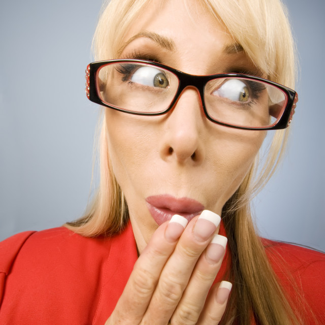"""""""Shocked woman in red making a funny face"""" stock image"""
