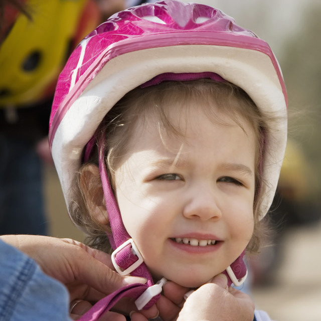 """Little girl in a bicycle helmet"" stock image"